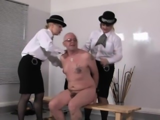 Uniformed femdoms punish subs ass roughly