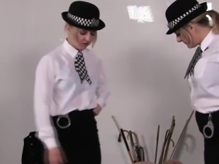 Police femdoms spanks subs butt with different objects