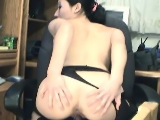 Asian skank cuts her stocking and toy masturbates