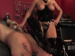 Busty femdom facesits while punishing subject