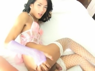 Teen ladyboy takes on a big white monstercock with her holes