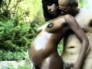 Preggy black beauty jerks off a grandpa in a public park