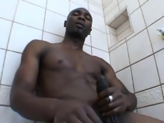 Black Boyfriend masturbating his cock on the bathroom