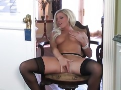 Niki Young with gigantic breasts and shaved snatch gives a closeup of her...