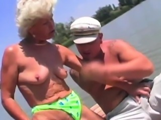 Hot Granny In Bikini Massages A Lonely Navigator