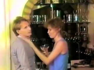 Retro couple foreplay over alcohol