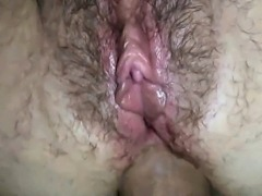 Hairy dude fucking and creampiing her asshole