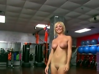 Lexi Swallow is a blonde that is giving a blow job. Her large breasts are...