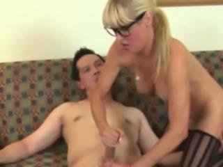 Handjob milf in stockings and glasses jerking