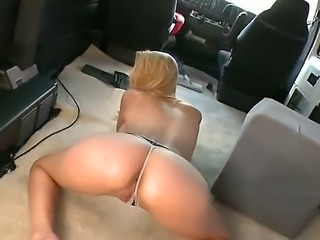 Alli May is a blonde that is payed some cash to get in the back of the van...