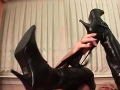 Blonde mature in leather boots masturbates