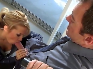 Blonde with nice big hooters is having gym sex with her trainer. She is...