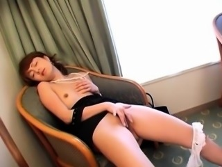 Mai Satsuki rubs her hairy crack and gets vibrator on clit