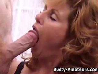 Busty Milf Mindy Jo sucking two cocks