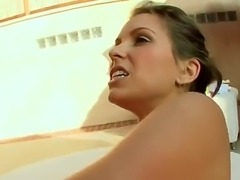 Courtney Cummz is a milf with huge tits. She is on her back and her pussy is...