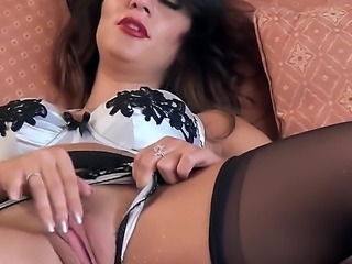 Dark haired adult model Roxy Mendez in beautiful lingerie bares her juicy boobs then spreads her stocking-clad legs to play with her pink snatch. She fingers her wet twat for your viewing enjoyment.