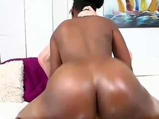 Curly haired black girl Bugatti Bubblez with nice booty gags on hard white cock on her knees and then enjoys some cock riding. She puts her brown butt on show as she bounces on that dick.