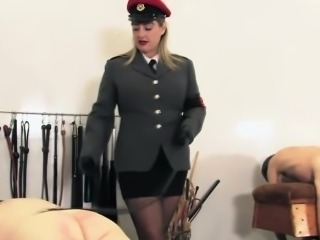 Mature dominatrix flogging her submissive asses