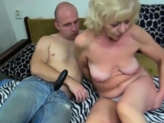 Granny playing with fake cock