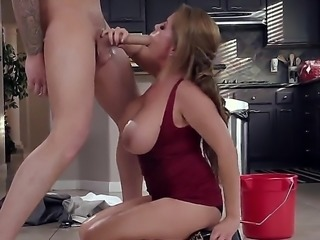 Clover is visiting his friends house and finds his friends mom in the kitchen. He offers to help. She accepts and pulls her huge tits out of her top to smear them with oil.