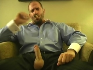 Hot muscle hunk smoking cigar and jacking