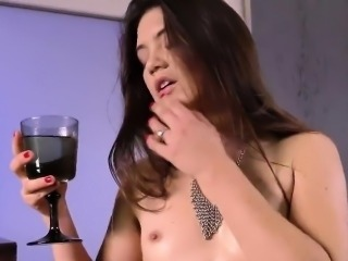 Stunning nympho is pissing and fingering shaved cunt