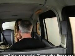 Stunning blonde gives footjob in fake taxi
