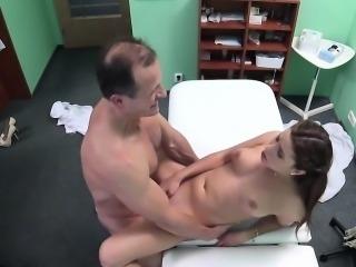 Doctor examining brunette in lingerie
