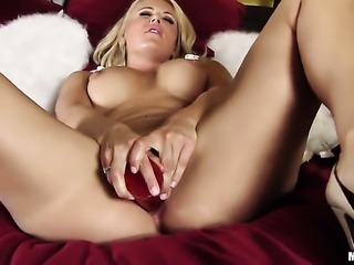 Solo girl is using a dildo