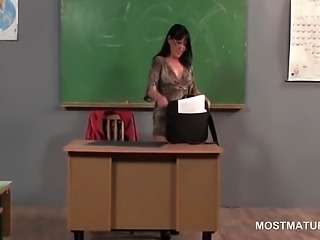 Mature teacher doing herself on the desk