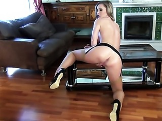 With huge breasts and trimmed bush playing with herself on camera