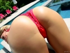 Stunning sexy Juelz Ventura poses in her red bikini by the pool for your...