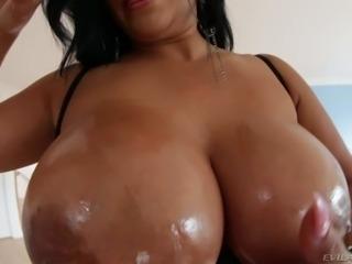 Dark haired curvy woman Kiara Mia in a short black dress shows off her giant...