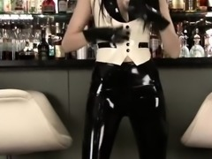 Latex fetish of sexy barmaid