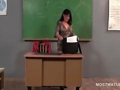 Mature teacher doing herself on the desk
