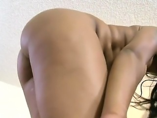 Ebony girl is massaging a cock with her firm natural tits. The brunette enjoys having interracial sex with a white dude and her tits get covered in cum.