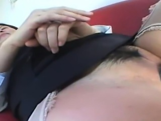 This Asian slut is lies back on the couch in her lingerie...