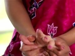 Asian masseuse rubs pussy