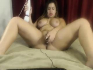 Busty brunette hottie is vibrating then fingering her wet f