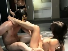 Two sexy women with nice boobs oil wrestling with dudes