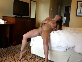 Busty girl is massaging her pussy