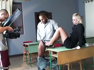 Blonde Kerry Louise with gigantic jugs keeps her legs apart to be pumped over...