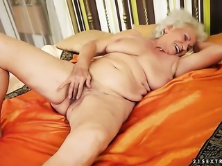Norma with juicy knockers cant live a day without playing with her pussy