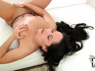 With tiny boobs and trimmed twat displays her neat pussy hole in solo scene