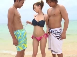 Beautiful Japanese babe gave a perfect blowjob to the guys out there, on the...