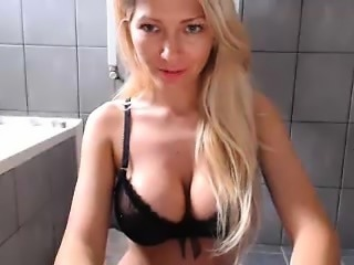 Busty blonde sets up her webcam to give a good view of her