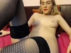 Sweet blonde in fishnet stockings sensually masturbates on
