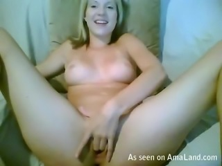 Sexy blonde babe makes a good show for her viewers. She fucks herself by...