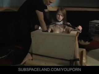 Enslaved slut big tits punishment in the bondage cage