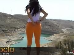 Pretty brunette girl with orange cameltoe